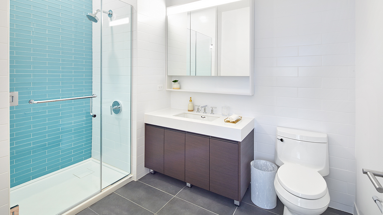 Rendering of a contemporary bathroom from a new luxury residence at The Mason in Mamaroneck, with features including Kohler fixtures, wood vanities, and polished white quartz countertops